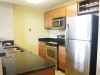 Kitchen w/ granite countertops and stainless steel appliances